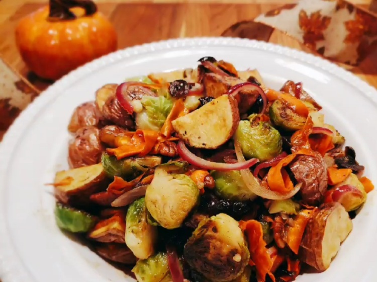 plate of roasted potatoes and brussle sprouts salad